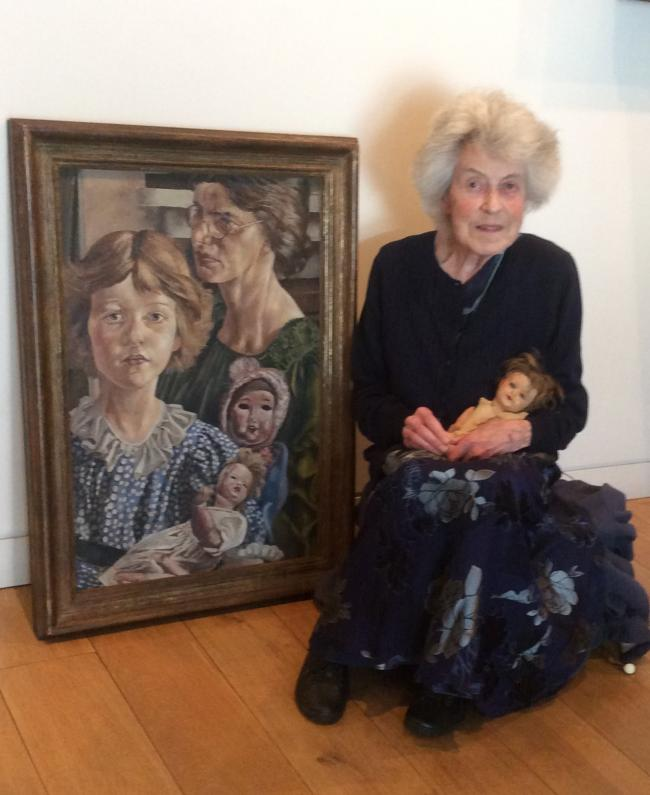 Stanley Spencer's daughter, Unity Spencer with one of her Father's paintings.