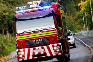 Firefighters tackle car crash