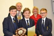 Rotary Club president, Chris Kelsey and head judge Lois Crane with the winning intermediate team: Left to right - Ted Aplin, William Peters and Miles Edwards (54746832)