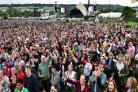 David Bowie fans celebrate the star in front of Glastonbury's Pyramid Stage