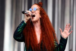 Jess Glynne dazzles in green sequinned suit at Glastonbury after missing out last year