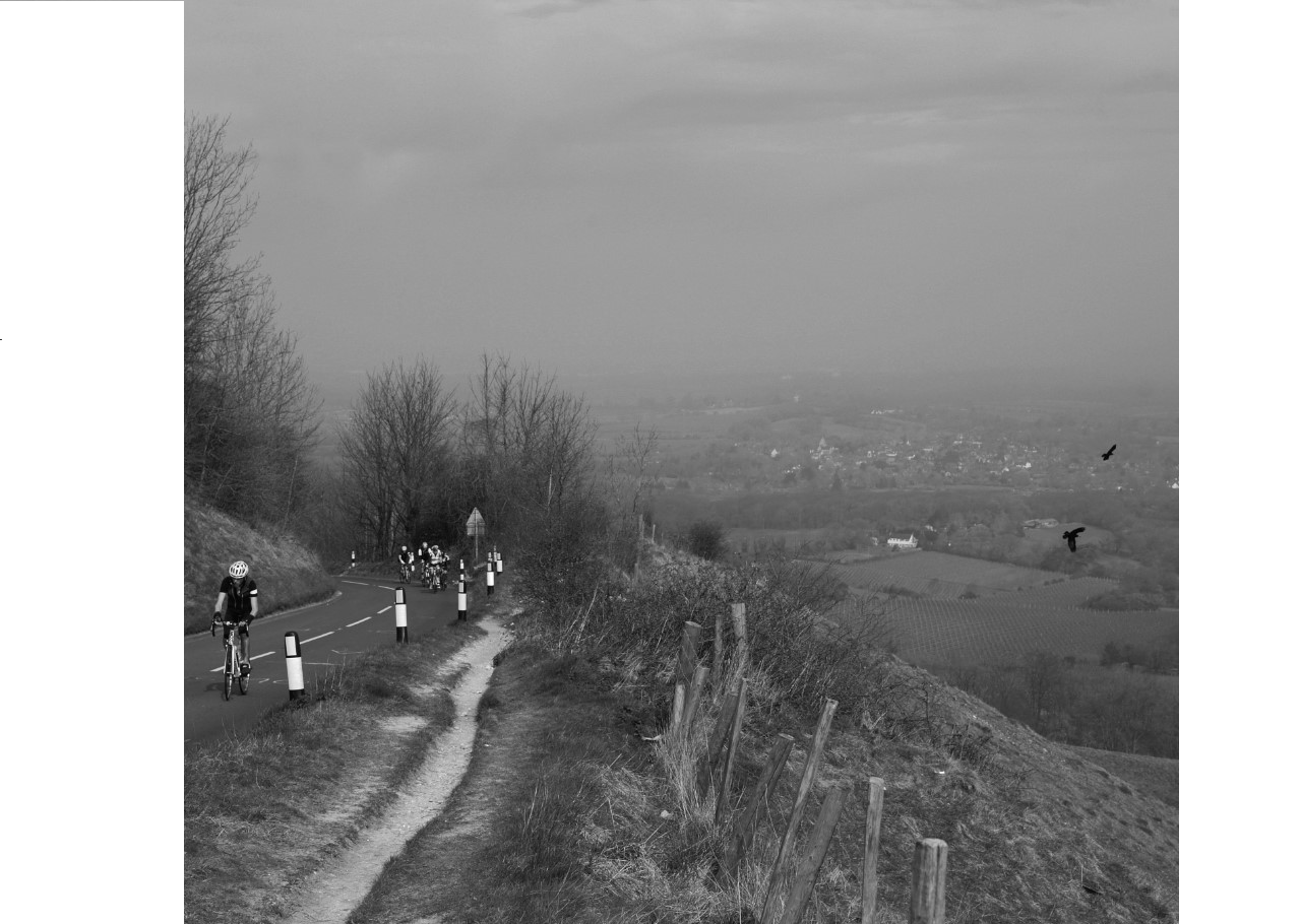Left, Graham cycling up Ditchling Beacon