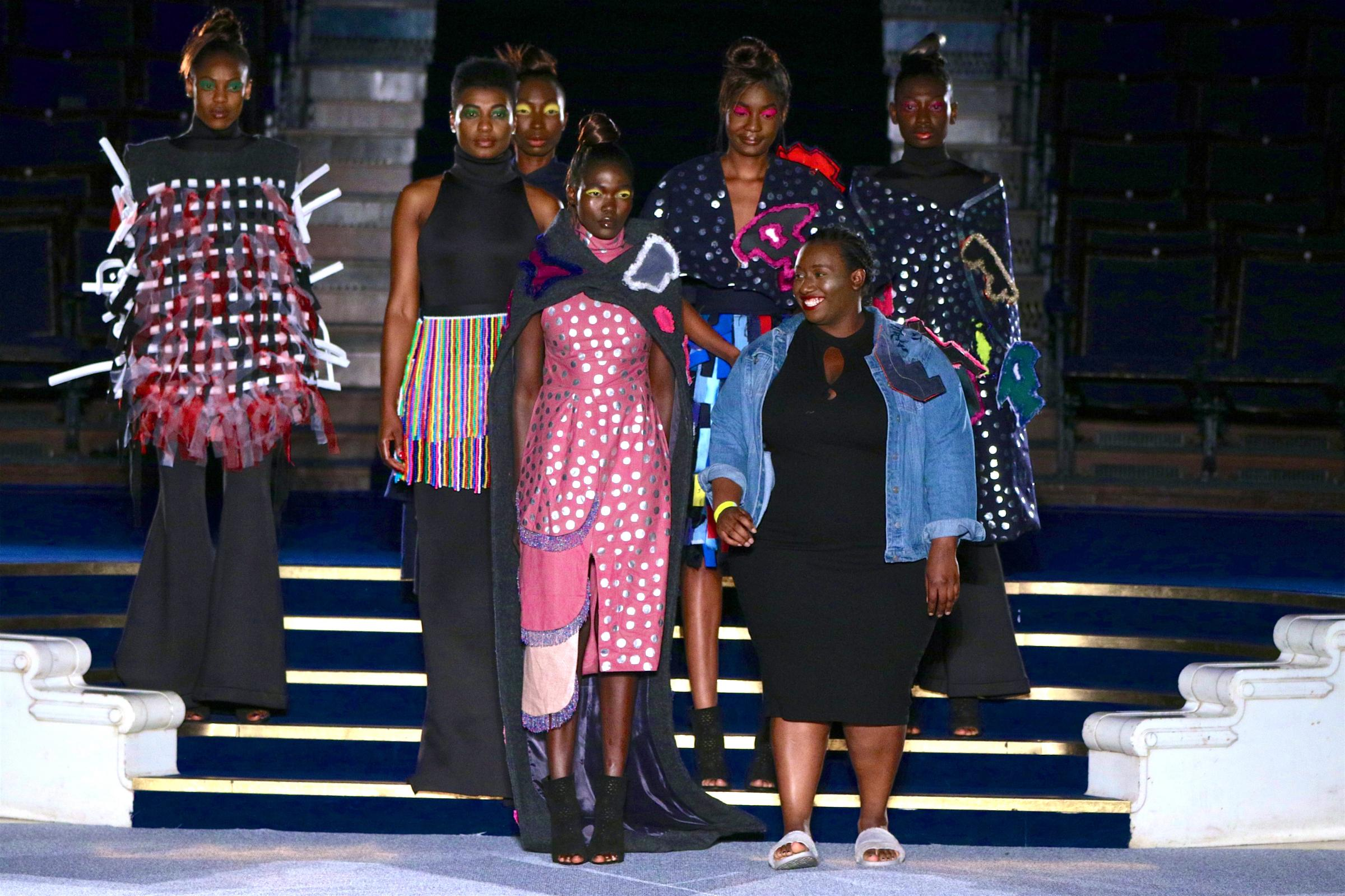 Nyasha Mabhunu (centre) with models wearing her designs on the catwalk