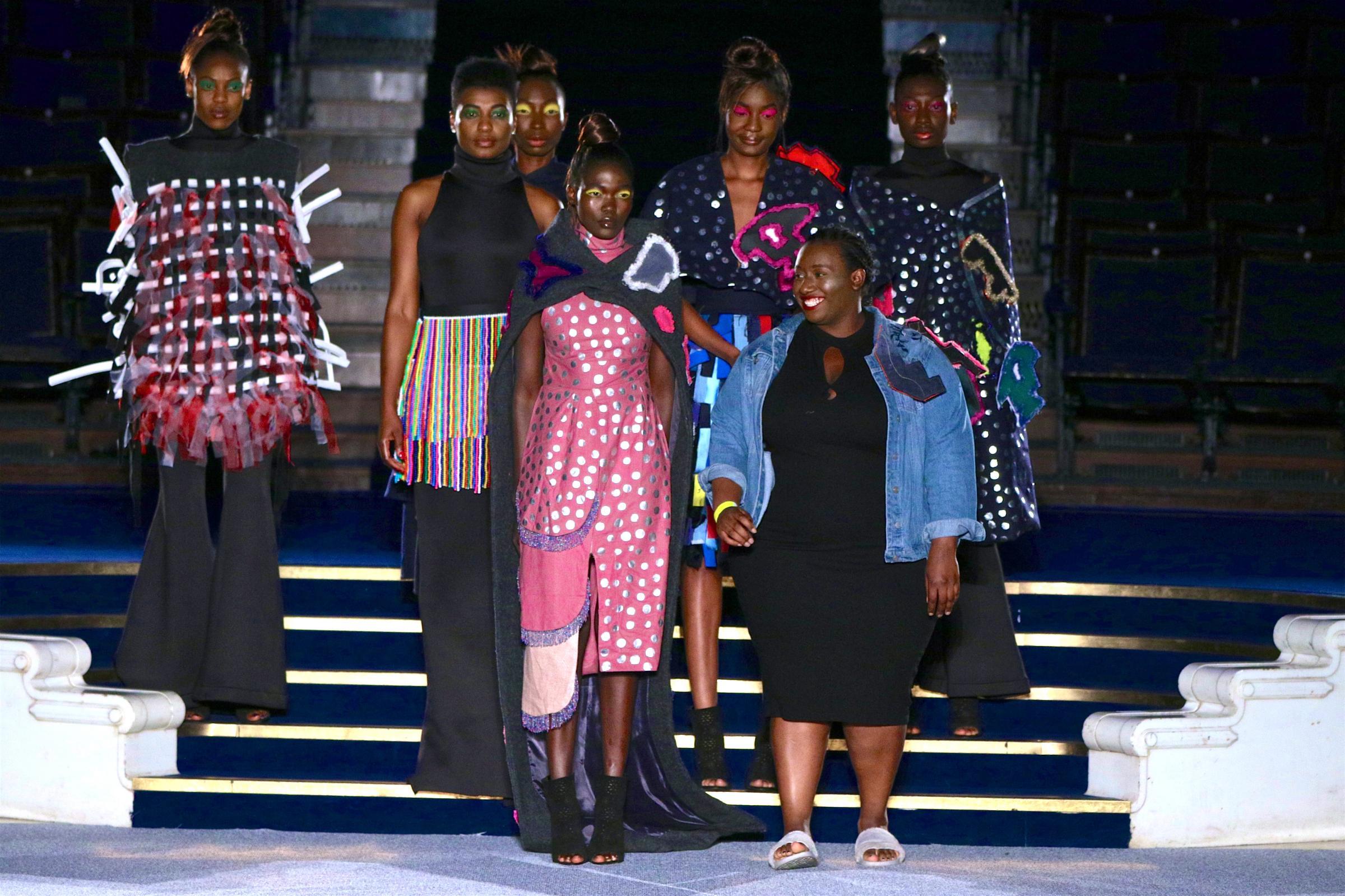 Nyasha Mabhunu (centre) with models wearing her designs on the catwalk