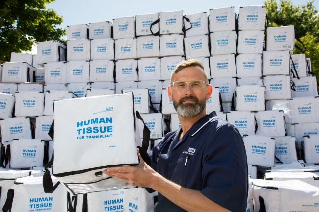 NHSBT nurse Marc Coe with empty transplant boxes