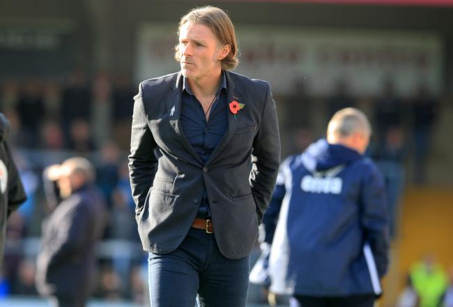 Ainsworth was proud of his side's draw at Sincil Bank