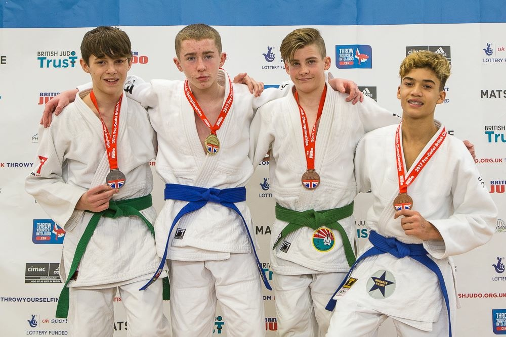 Young stars celebrate championship medal haul