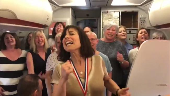 WATCH: Singing group entertains passengers with performance on delayed flight