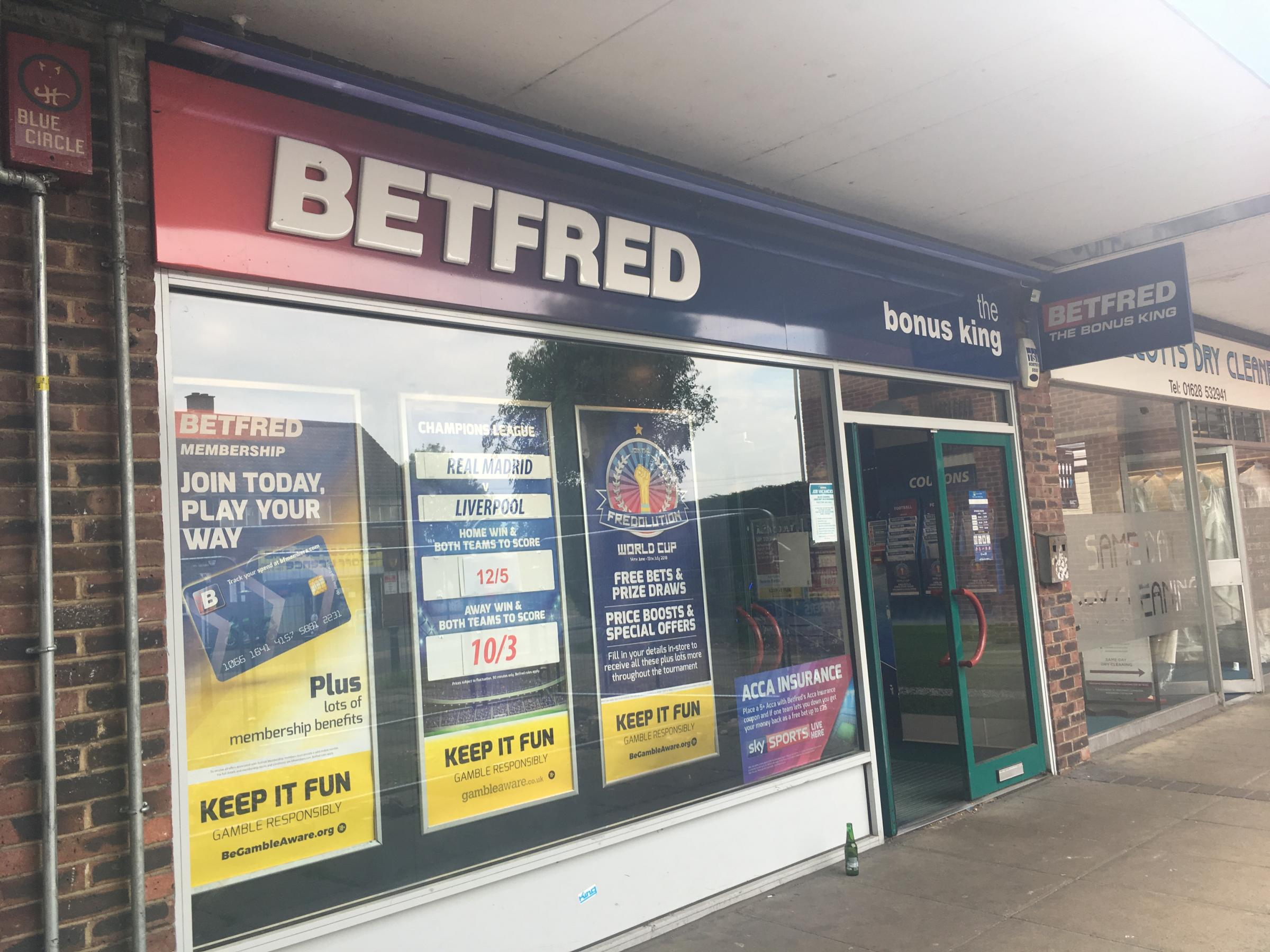 Knife-wielding robber jumps over betting shop counter and steals cash