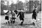 Boy Scouts carrying camping equipment walk across a field at Handy Cross, High Wycombe, April 1960
