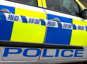Armed robber who struck at McColls is on the run