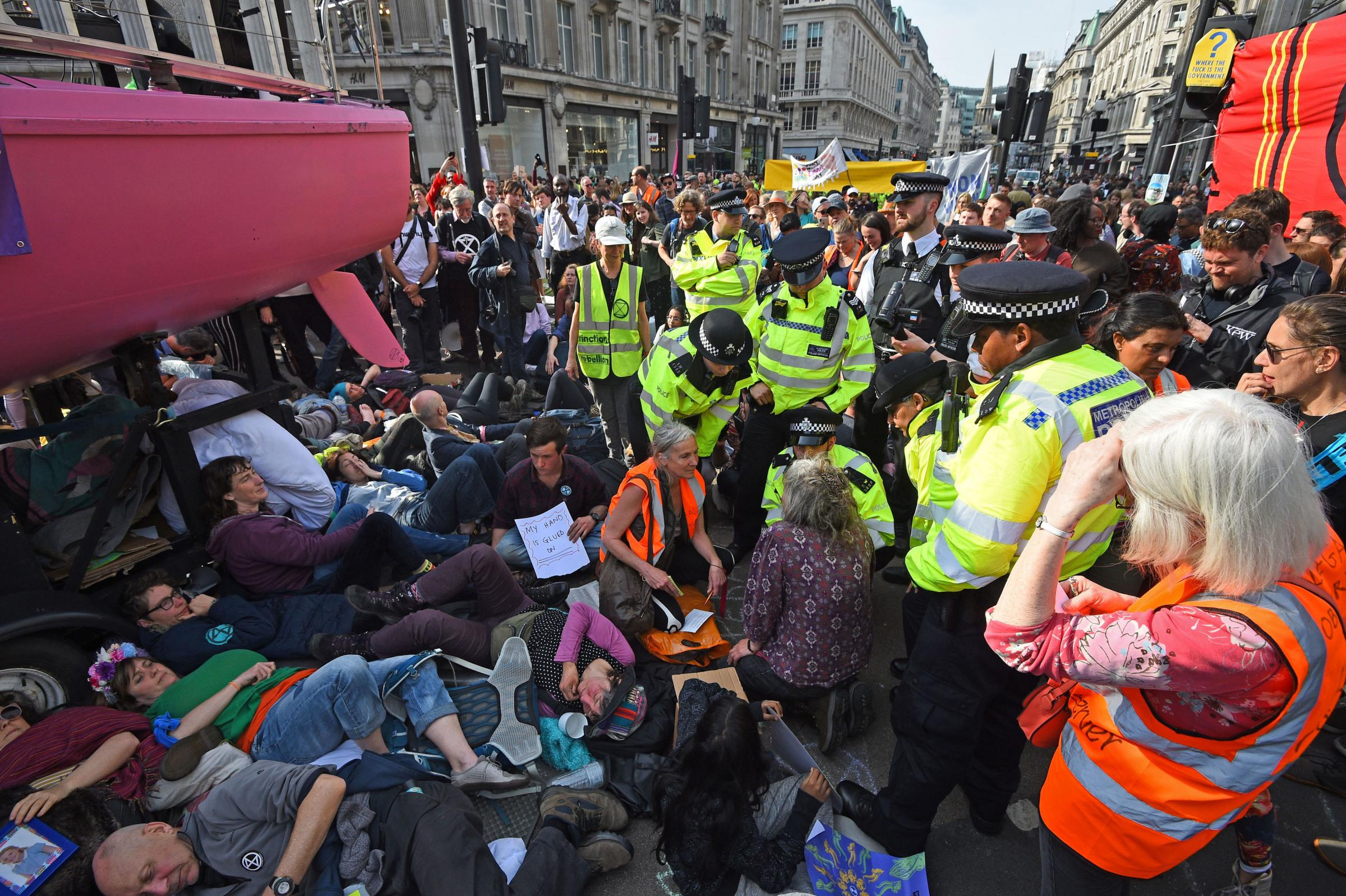 Police officers with climate activists from an Extinction Rebellion demonstration at Oxford Circus, London Kirsty O'Connor/PA Wire