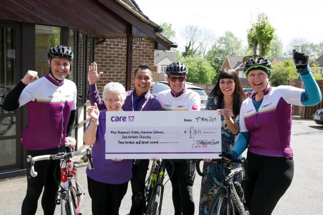 The cyclists presented with a cheque at Catherine Court