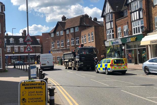 Emergency services near town centre amid reports a pedestrian hit by lorry